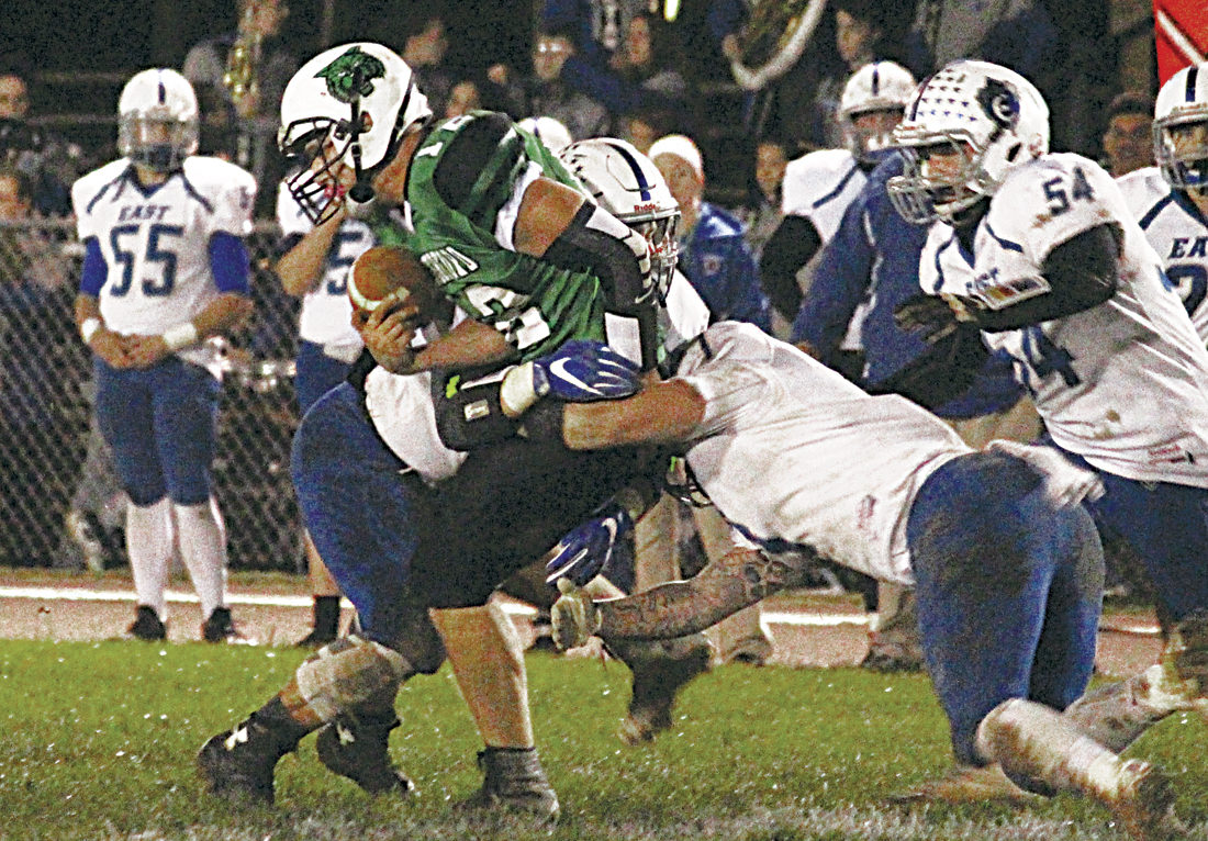Waterford's Peyton Stephens (12) carries the ball during a high school football playoff game against Sciotoville East Friday night. Photo by Patti Miller.