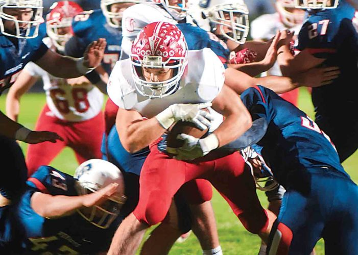Photo by Jeff Baughan Parkersburg's Tyler Moler moves past the Parkersburg South defense for a touchdown Friday during the annual crosstown rivalry game. With the 27-24 victory, Parkersburg High School clinches a home game in the first round of the West Virginia Class AAA playoffs.