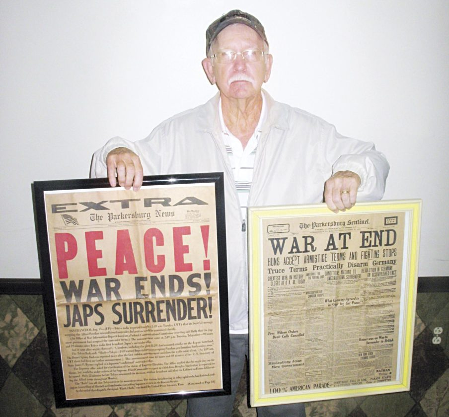 Photo by Jess Mancini Jerry Smith of Parkersburg holds two historic issues of The Parkersburg News and The Parkersburg Sentinel that announce the end of World War I and World War II. Smith obtained the old newspapers from his brother, Ray, and from the Rinky Dinks flea market in Marietta.