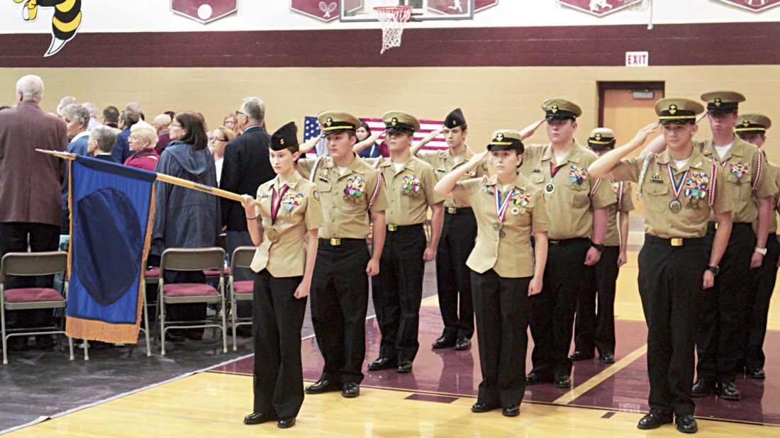 Photo by Michael Erb Members of the Parkersburg High School Navy Junior ROTC stand at attention Monday at the beginning of Williamstown High School's annual Veterans Day Assembly.