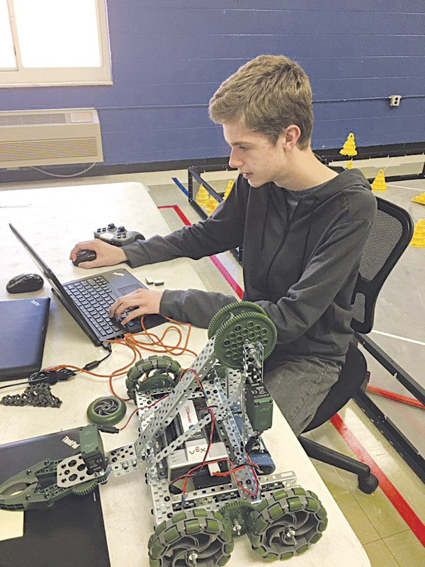 Photos provided Ripley High School senior John Alex Lowe is a programmer in his school's VEX Robotics program. He says he has a love of science and technology born out of curiosity in how things work and how things are made.