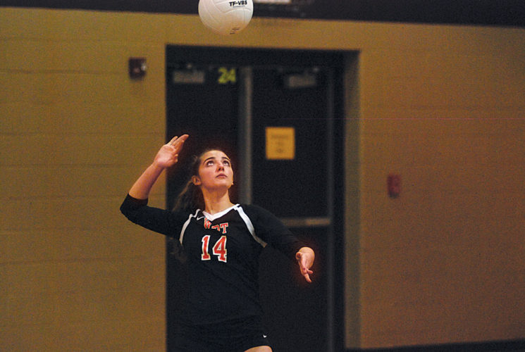 Wirt County senior Mahala Greenleaf, who has 77 aces this season, prepares to serve the ball during a match earlier this year. The Tigers are attempting to reach the Class A state finals for a third straight year and face off against Tyler Consolidated at 1:30 p.m. today in the state quarterfinals at the Charleston Civic Center. Photo by Jay W. Bennett.