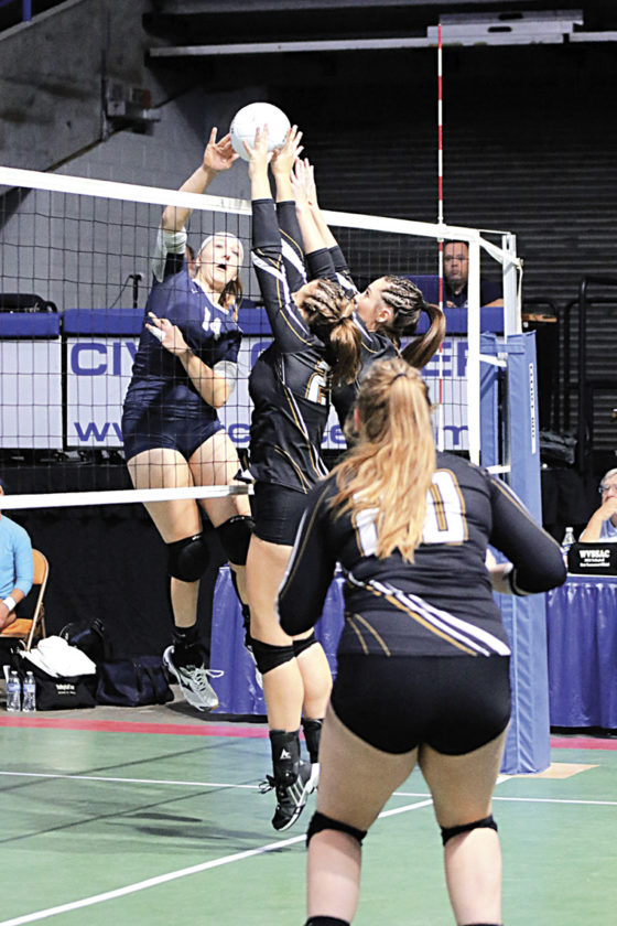 Ritchie County's Kenda Osborne (14) spikes the ball during a state volleyball match against Williamstown Friday in Charleston. Ritchie won in five sets. Photo by Michael Uhl