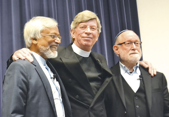 Photo by Michael Kelly The Interfaith Amigos — Imam Jamal Rahman, left, Pastor Don Mackenzie, center, and Rabbi Ted Falcon, right — spoke, laughed and even sang to a group of about 300 people in the Alma McDonough Auditorium at Marietta College.