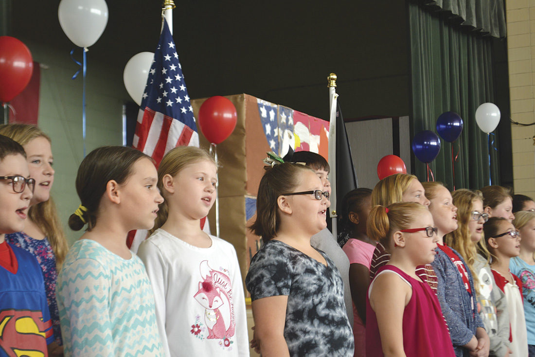 Photo by Michael Kelly Children at Harmar Elementary School sing patriotic songs to honor their guest veterans on Thursday.