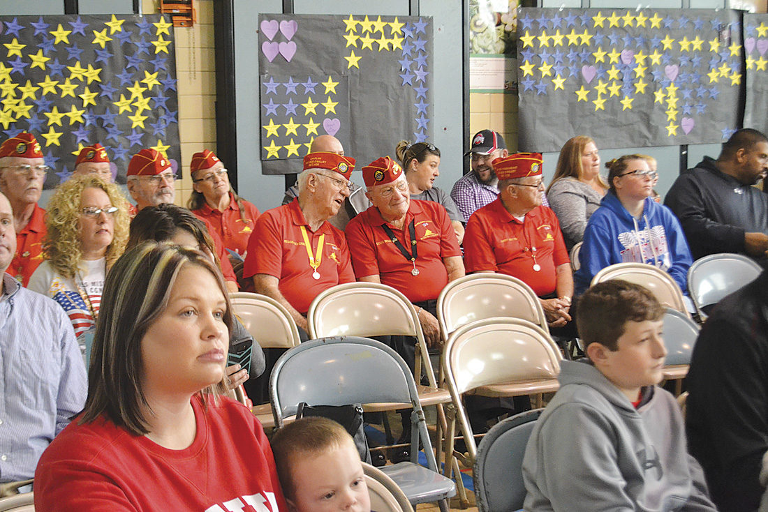 Photo by Michael Kelly Members of the Marine Corps League Post 1436 sit with other veterans and parents during the annual Veterans Day program held Thursday at Phillips Elementary School.
