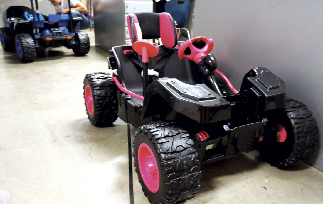 Photo by Michael Erb Students at the Caperton Center are designing and customizing battery-powered, ride-on cars for children with special needs. The finished vehicles will be unveiled at an event Monday evening at the center.