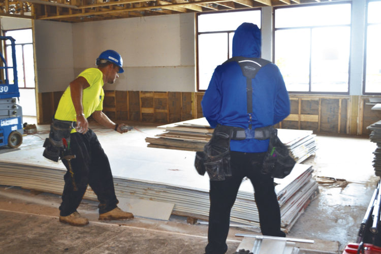 Photo by Erin O'Neill Employees of North Coast Construction were working recently to hang drywall inside the new Marietta IHOP restaurant.