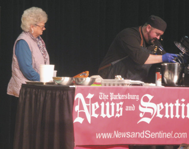 Photo by Jeffrey Saulton Chef Chad Winebrenner, right, makes the first prize bread, Cranberry Nut Bread with Filling with Patricia Burdine, of Williamstown.
