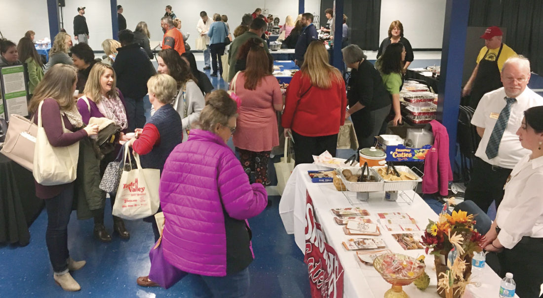 Photo by Christina Myer Attendees at Saturday's Taste of The Valley event at Parkersburg South High School check out vendors prior to the cooking demonstration.