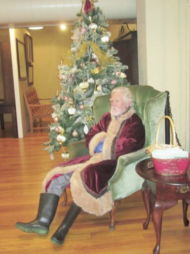 Photo by Wayne Towner Father Christmas was portrayed in his Victorian costume by Eybie Eyberg during the Trees of Our Heritage opening reception Sunday at the Blennerhassett Museum of Regional History.