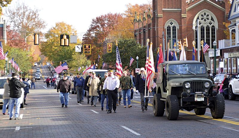Photo by Doug Loyer Veterans walk down Putnam Street during Saturday's annual Marietta Veterans Day Parade.