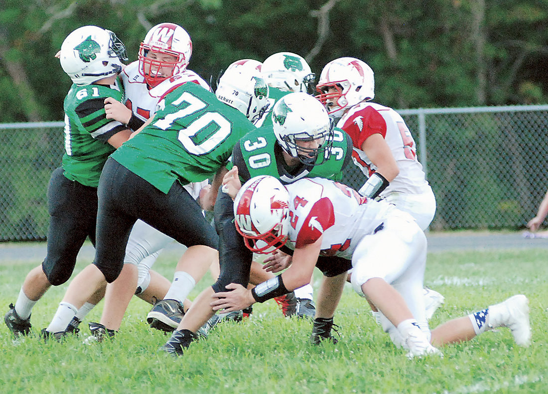 Waterford's Braden Bellville and company battle for yardage during a high school football game against Wahama earlier this season.