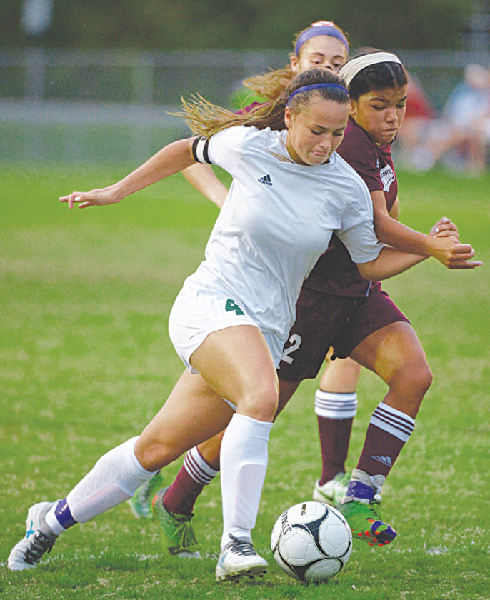 Winfield's Sydney Cavender drives the ball down the field as GW's Destiny Jackson attempts to stop her during the Winfield Lady Generals-George Washington Lady Patriots soccer game earlier this season at Winfield High School. Photo courtesy of Craig Hudson.