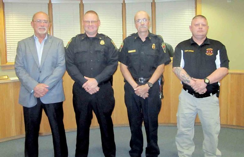 Belpre Mayor Mike Lorentz swore in two new officers in the Belpre Volunteer Fire Department at Monday's meeting of Belpre City Council. Lorentz, far left, and Fire Chief Tony Cronin, far right, stand with newly promoted Captain Bryan Harpold, center left, and newly promoted Lieutenant Jerry Hampton, center right. (Photo by Wayne Towner)