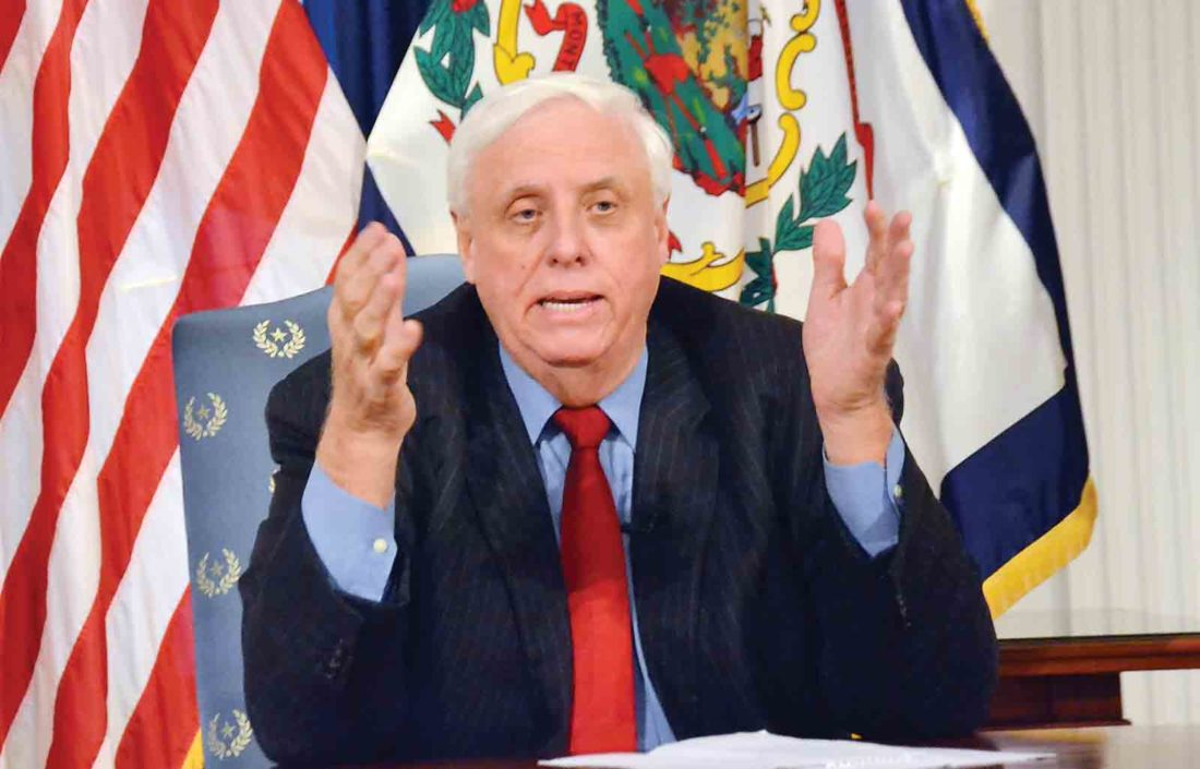 Gov. Jim Justice talks about the potential benefits for West Virginia following the recent announcement that a Chinese energy company is planning to invest $83.7 billion to develop the state's natural gas resources over the next 20 years, during a press conference at the state Capitol Monday morning. (Photo by Brett Dunlap)