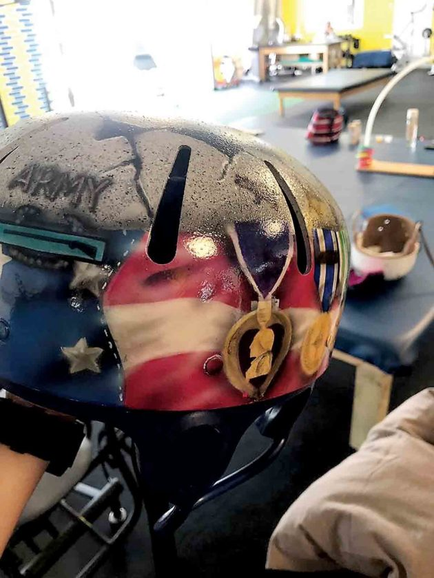 Thanks to the collaborative effort of Robyn Yeager and Kim and John Shatney, veteran Anson Curry now has a protective helmet he can take pride in. (Photo Provided)