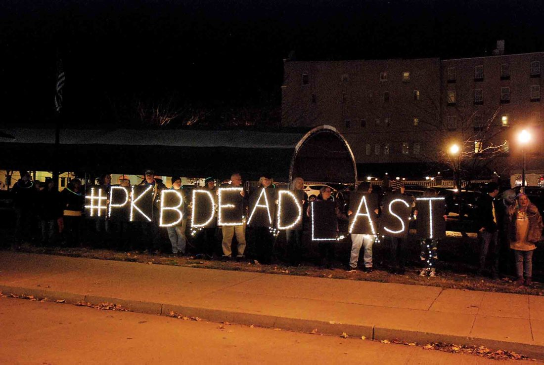 """Photos by Evan Bevins Members of Fairness Parkersburg demonstrate outside the Municipal Building prior to Tuesday's Parkersburg City Council meeting. The hashtag """"PKBDeadLast"""" refers to the city's poor showing on the Municipal Equality Index, a survey of LGBTQ protections released by the Human Rights Campaign. (Photo by Evan Bevins)"""