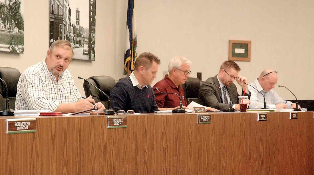 Parkersburg City Council President J.R. Carpenter, left, speaks during Tuesday's council meeting. Also pictured are, from second from left, Councilmen Mike Reynolds, John Reed, Zach Stanley and Jeff Fox. (Photo by Evan Bevins)
