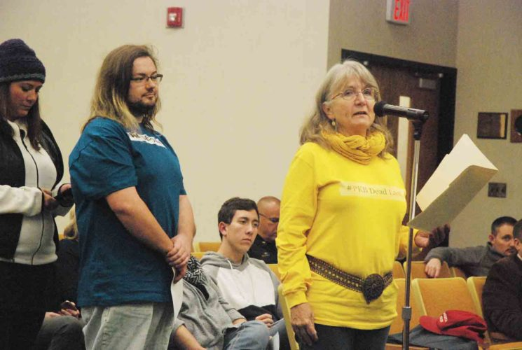 Parkersburg resident Susan Sharp, right, leads off a statement from members of Fairness Parkersburg during Tuesday's Parkersburg City Council meeting, with supporters Daniel Miller, center, of Vienna and Megan Reynolds of Parkersburg waiting to pick up where she left off. (Photo by Evan Bevins)