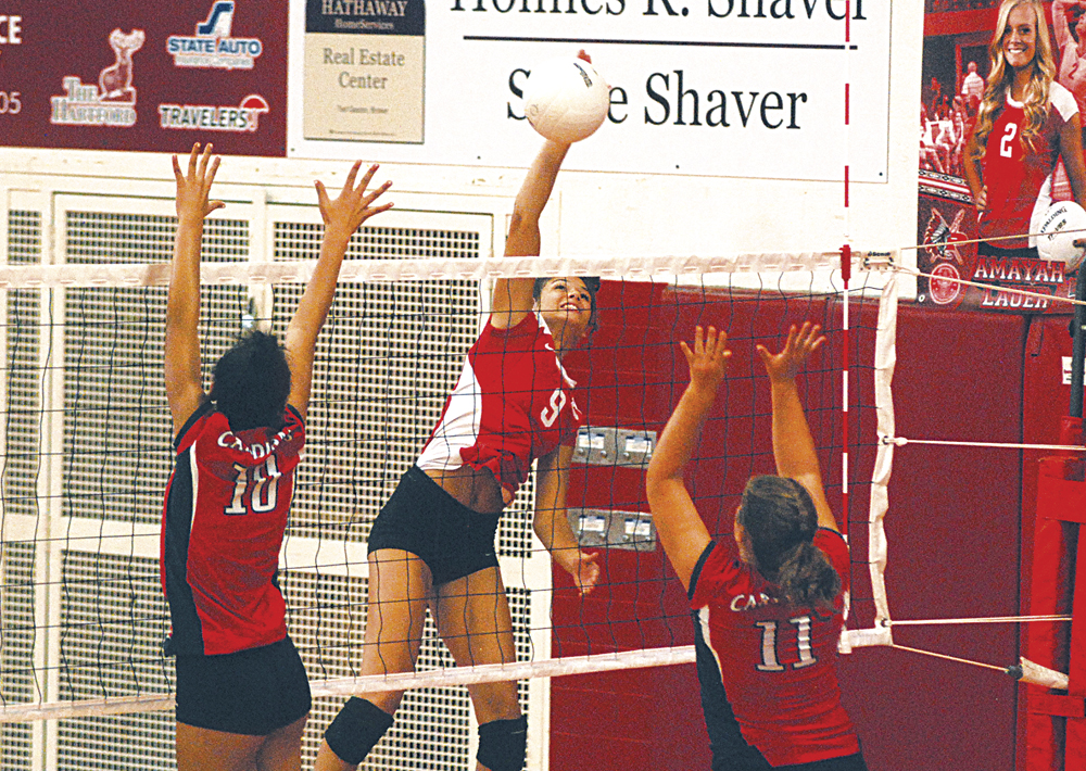 Parkersburg High School junior Shay-Lee Kirby, pictured here spiking the ball in a match earlier this year inside Memorial Fieldhouse, was selected first team all-Mountain State Athletic Conference. Photo by Jay W. Bennett.