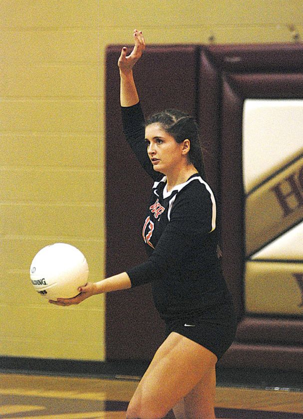 Wirt County senior Katie Frazier, pictured here getting ready to serve the ball during a match earlier this year at Williamstown, was honored by league coaches as the Little Kanawha Conference's Player of the Year. Photo by Jay W. Bennett.