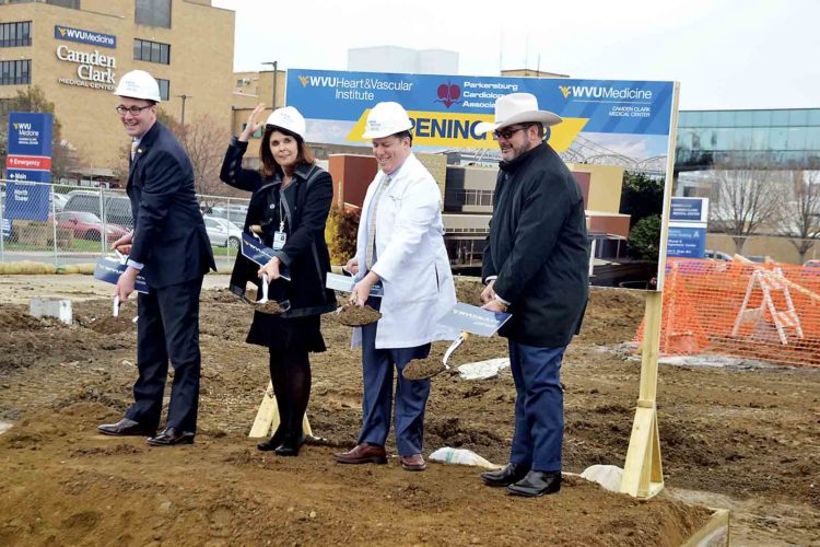 Photo by Brett Dunlap Albert Wright, president and chief executive officer of WVU Medicine; Karen Bowling, interim chief executive officer for the Camden Clark Medical Center; Dr. David Gnegy, cardiologist with Parkersburg Cardiology Associates; and Parkersburg Mayor Tom Joyce officially break ground for the cardiac services building at the Camden Clark Medical Center Thursday.
