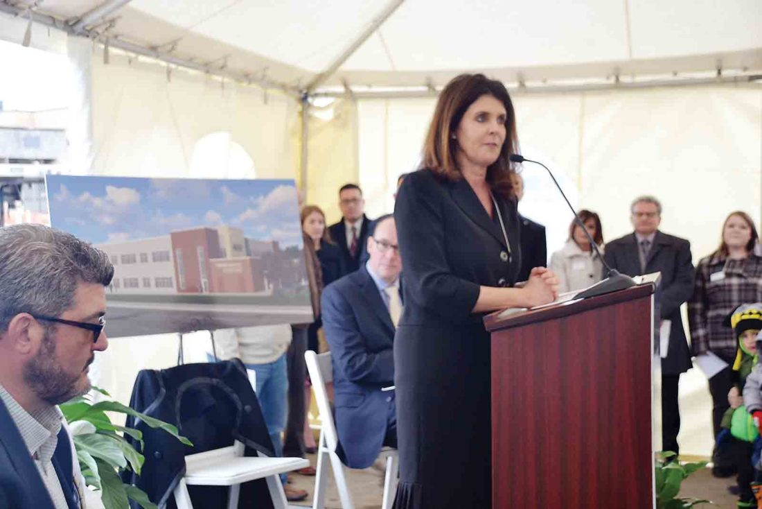 Photo by Brett Dunlap Karen Bowling, interim chief executive officer for the Camden Clark Medical Center, greets over 100 people who gathered at the medical center Thursday for the official groundbreaking to commemorate the construction of the cardiac services building.