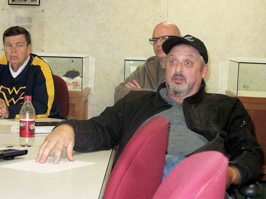 Photo by Evan Bevins Parkersburg City Council President J.R. Carpenter asks questions about a proposal to raise police and fire fees during a council Finance Committee meeting Thursday at the Municipal Building.