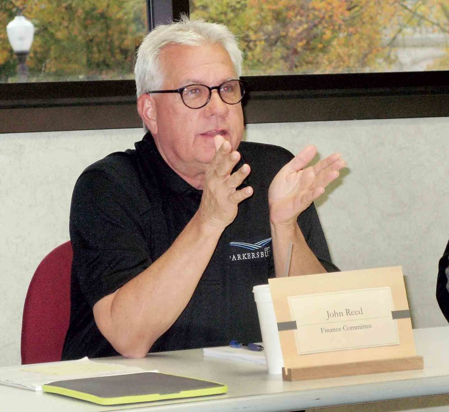 Photo by Evan Bevins Parkersburg City Council Finance Committee Chairman John Reed discusses plans to generate additional funds to address increased fire and police pension payments and construction of fire stations during a committee meeting Thursday at the Municipal Building.