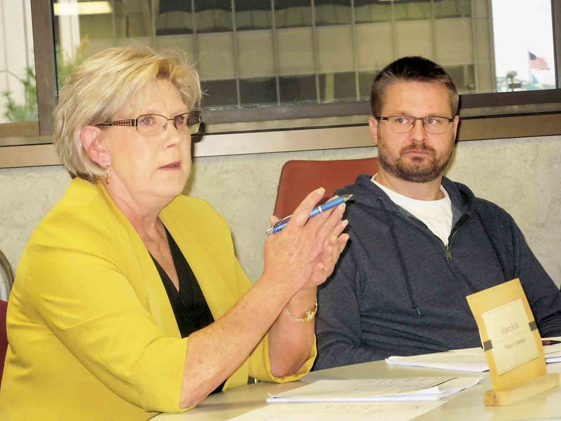 Photo by Evan Bevins Parkersburg City Councilwoman Sharon Kuhl, left, speaks during a Finance Committee meeting Thursday as Councilman Zach Stanley listens.