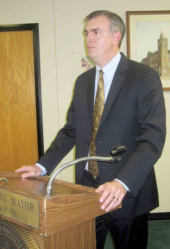 Photo by Wayne Towner Wood County Circuit Judge Jason Wharton, who serves as judge for the Wood County Drug Court program, speaks Friday during a graduation ceremony for five of the program's participants.
