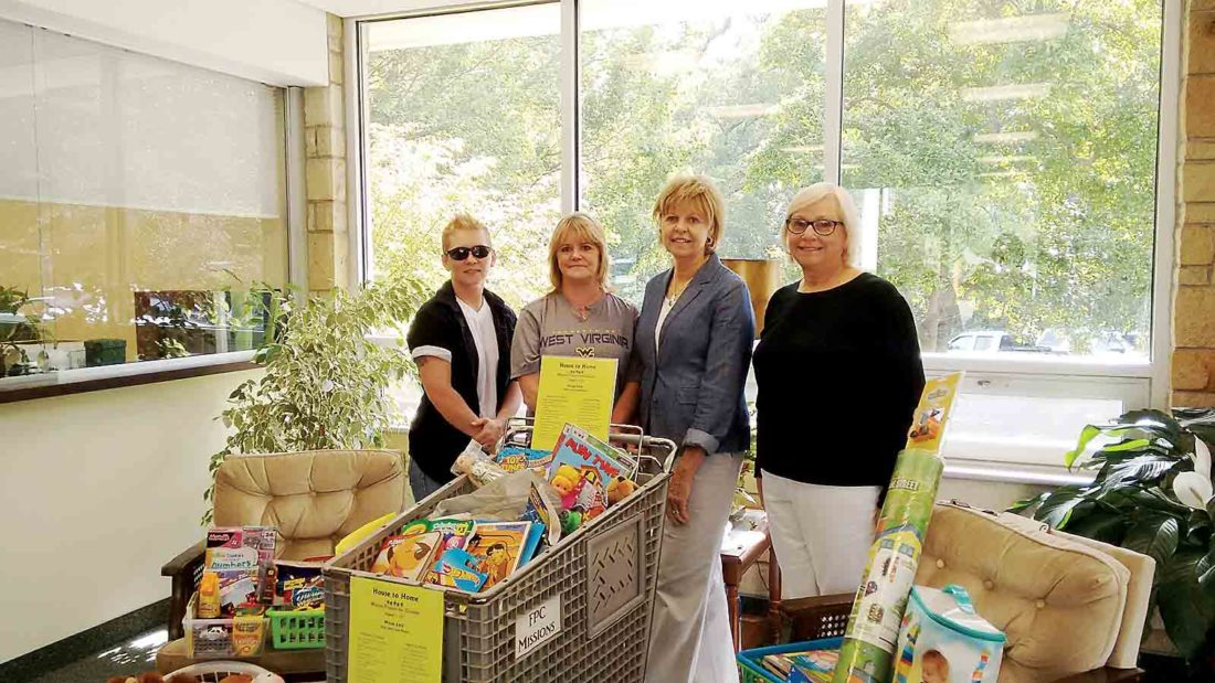 Photo Provided First Presbyterian Church's mission was to help create a children's corner at House to Home in Parkersburg and donate toys for young children. From left are Jessy Towner of House to Home, Dawn Eddy of House to Home and Kay Dunn and Barbara Lucas from First Presbyterian Church.