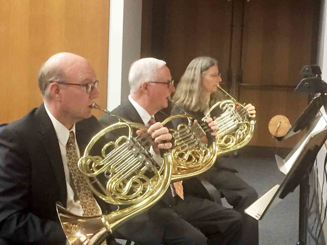 "Photo Provided Three members of the West Virginia Symphony Orchestra French horn section play a special antiphonal section of ""Rumpelstiltzkin,"" featuring from left Tom Beal, Luke Zyla and Marsha Palmer."