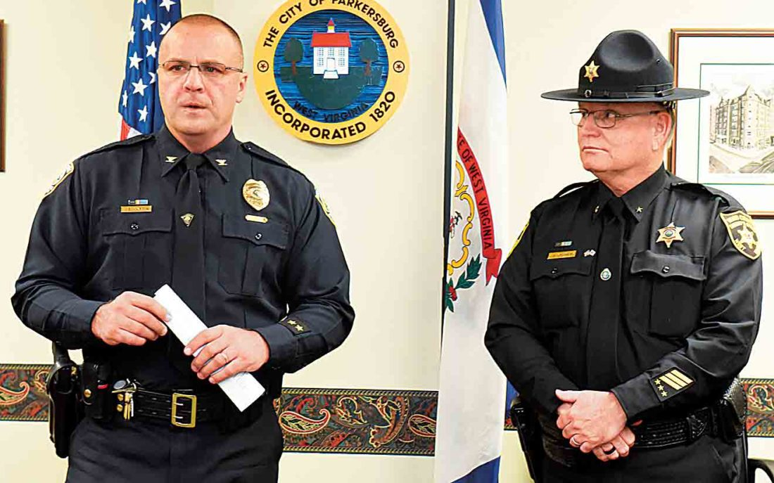 Photo by Jeff Baughan Parkersburg Police Chief Joe Martin addresses media Friday afternoon as Wood County Sheriff Steve Stephens, right, listens. Martin, speaking for the Parkersburg Violent Crime and Narcotics Task Force, issued brief remarks about a series of arrests Friday with the cooperation of the FBI and the narcotics task force.