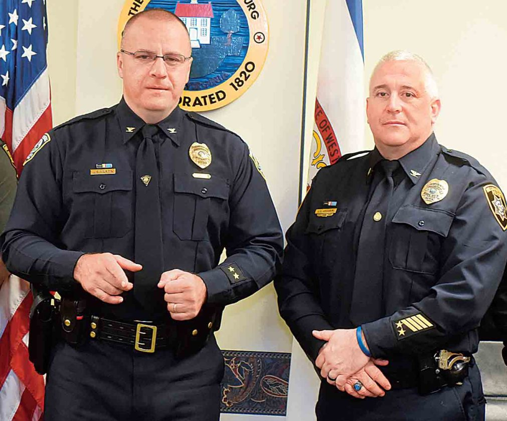 Photo by Jeff Baughan Parkersburg Police Chief Joe Martin addresses media Friday afternoon as Williamstown Police Chief Shawn Graham, right, listens.
