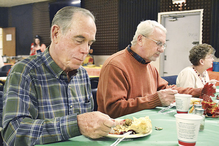 File Photo Williamstown residents Tom Rowell, 74, and Bruce Holmes, 69, enjoy the community Thanksgiving dinner hosted by American Legion Post 159 in Williamstown last year. Post 159 will be hosting its dinner again this year on Nov. 23.