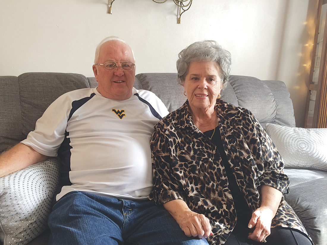 Photo by Brett Dunlap Raymond and Yvonne Cox will celebrate their 60th anniversary on Nov. 24. The couple were married in 1957 at the Elizabeth Baptist Church in Wirt County by the Rev. Varil Winter.