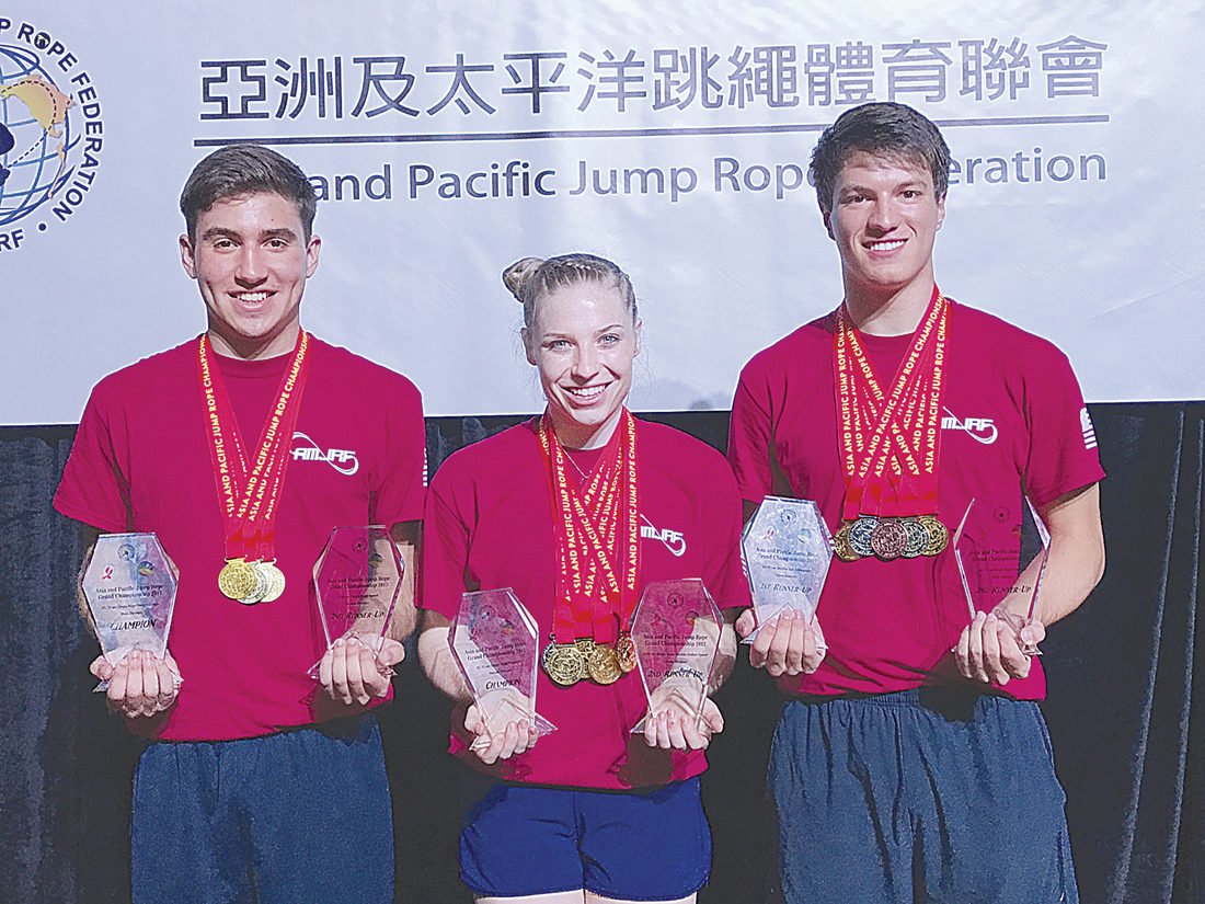 Photo Provided Noah Mancuso of Vienna, Tori Boggs of Vienna and Graham Booth of Cary, N.C., with their medals and awards from the Asia and Pacific Jump Rope Championships in Hong Kong in August.