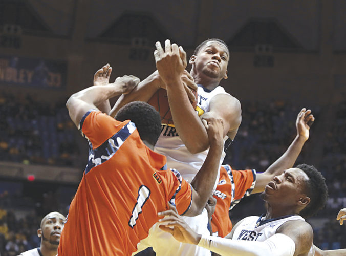 West Virginia forward Sagaba Konate (50) grabs a rebound from Morgan State guard LaPri McCray-Pace (1) during the first half of an NCAA basketball game Saturday in Morgantown.