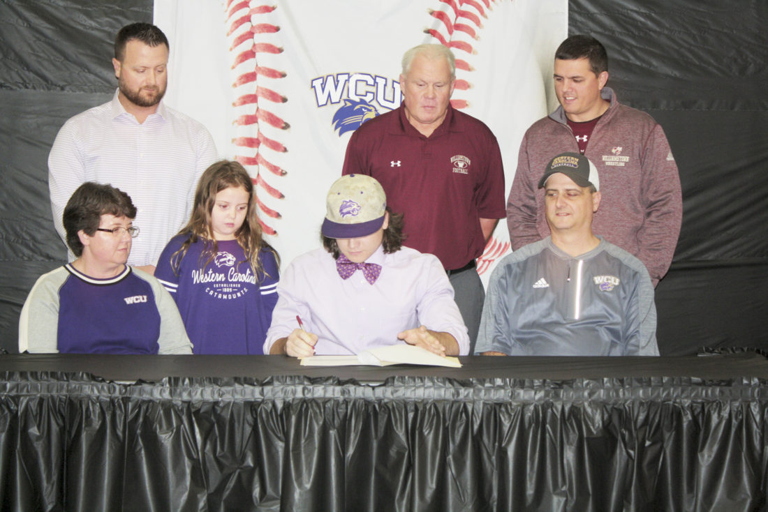 Williamstown's MasonAdkins signs his National Letter of Intent to the NCAA's Division IWestern Carolina University baseball team Sunday at Williamstown First United Methodist Church. Adkins made school history as the first Yellowjacket baseball player to sign with a Division Ischool.  Photo by Joe Albright