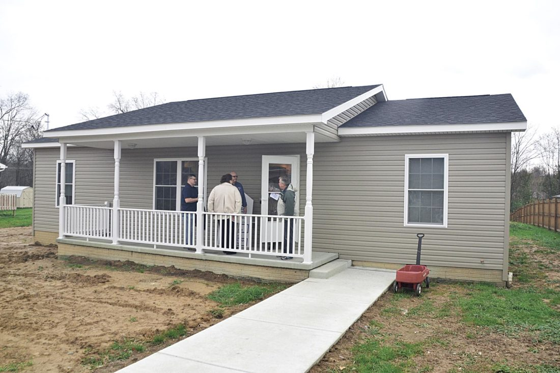 Photo by Brett Dunlap The Smiths took possession of their house, the 98th home built locally by Habitat. The home is located at 2407 Seventh Ave. in south Parkersburg.