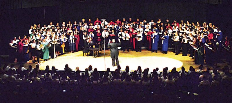 Photo by Doug Loyer Dr. Jay Dougherty, Director of Choral Activities at Marietta College, directs the High School Honors Choir during its performance Saturday in the Warren High School auditorium.