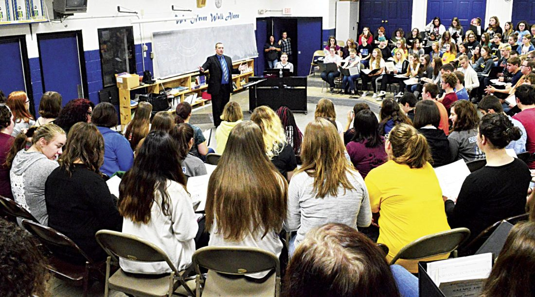 Photos by Doug Loyer Dr. Jay Dougherty, Director of Choral Activities at Marietta College, instructs the High School Honors Choir during practice.
