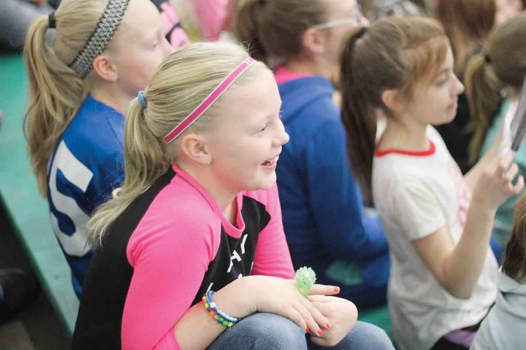 Kaylie McCutcheon gets excited when other students at Waterford Elementary are recognized for being kind, positive and helpful during a PAWS assembly at her school on Tuesday. (Photo by Janelle Patterson)