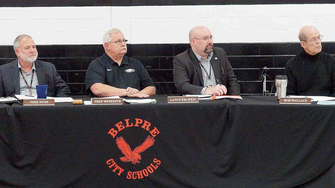 Belpre City Schools Superintendent Tony Dunn, left, Belpre Board of Education President Fred Meredith, center left, Treasurer Lance Erlwein, center right, and board member Bob Wallace, right, listen to a presentation during Monday's school board meeting. The board is seeking applications for a new member to replace Wallace who did not run for re-election. The applications will be accepted through Nov. 30. (Photo by Michael Erb)