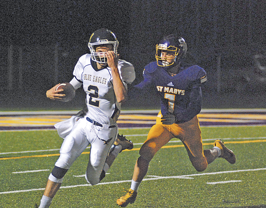 St. Marys junior defensive back Isaak Mooney tries to chase down Magnolia signal-caller Pat Mirandy in a game earlier this year at Bill Hanlin Stadium. Photo by Jay W. Bennett.