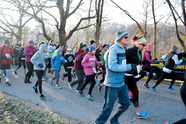 Runners and walkers take off after the sounding horn starts at the Devola Turkey Trot on Thanksgiving morning. (Photo by Michael Kelly)