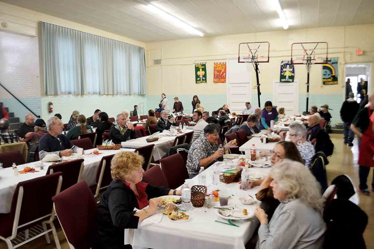 Families celebrate Thanksgiving at the Norwood United Methodist Church on Colegate Drive. The church has been offering a free Thanksgiving Day meal for 28 years. (Photo by Michael Kelly)