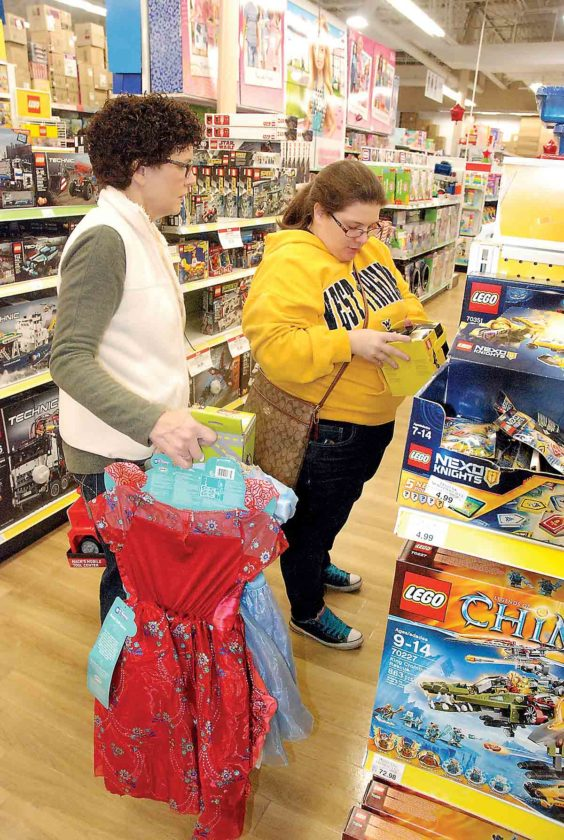 Photo by Evan Bevins Mineral Wells resident Janie Pennock, left, and her daughter, Amy Traugh of Parkersburg, look at Lego sets as they shop Friday at Toys R Us in Vienna.